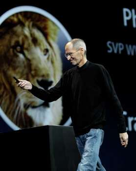 Apple CEO Steve Jobs talks about Lion during a keynote address to the Apple Worldwide Developers Conference in San Francisco, Monday, June 6, 2011.  (AP Photo/Paul Sakuma) Photo: Paul Sakuma