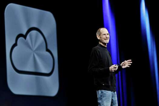 Apple CEO Steve Jobs introduces iCloud during a keynote address to the Apple Worldwide Developers Conference in San Francisco, Monday, June 6, 2011.  (AP Photo/Paul Sakuma) Photo: Paul Sakuma