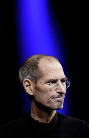 Apple CEO Steve Jobs is shown during a keynote address to the Apple Worldwide Developers Conference in San Francisco, Monday, June 6, 2011. (AP Photo/Paul Sakuma) Photo: Paul Sakuma