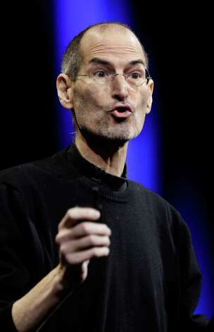 Apple CEO Steve Jobs gives the keynote address to the Apple Worldwide Developers Conference in San Francisco, Monday, June 6, 2011.  (AP Photo/Paul Sakuma) Photo: Paul Sakuma