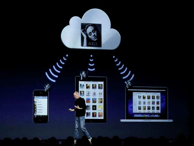Apple CEO Steve Jobs talks about the music component of iCloud at the Worldwide Developers Conference in San Francisco, Monday, June 6, 2011. (AP Photo/Marcio Jose Sanchez) Photo: Marcio Jose Sanchez / AP
