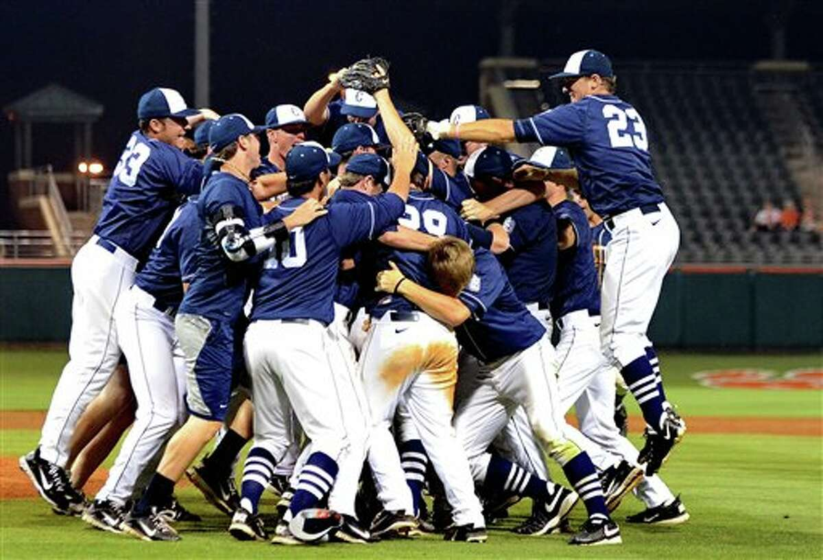 Connecticut players celebrate their 14-1 win over Clemson at an NCAA college baseball regional tournament game at Doug Kingsmore Stadium Monday, June 6, 2011, in Clemson, S.C. (AP Photo/ Richard Shiro)