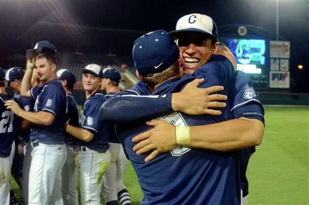 Connecticut's George Springer, Back, and Nick Walsh celebrate their 14-1 win over Clemson at an NCAA college baseball regional tournament game at Doug Kingsmore Stadium Monday, June 6, 2011, in Clemson, S.C. (AP Photo/ Richard Shiro) Photo: AP
