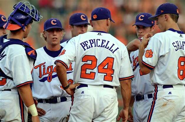Clemson pitching coach Dan Pepicelli talks to his players during an NCAA college baseball regional tournament game against Connecticut at Doug Kingsmore Stadium Monday, June 6, 2011, in Clemson, S.C. (AP Photo/ Richard Shiro) Photo: AP