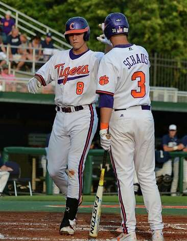 Clemson's Richie Shaffer (8)  is congratulated by Jeff Schaus (3) after scoring during an NCAA college baseball regional tournament game against Connecticut at Doug Kingsmore Stadium Monday, June 6, 2011, in Clemson, S.C. (AP Photo/ Richard Shiro) Photo: AP