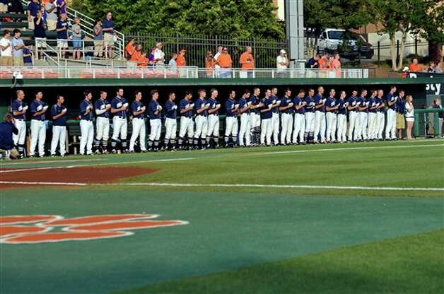 The Connecticut Huskies line up for the national anthem during an NCAA college baseball regional tournament game against Clemson at Doug Kingsmore Stadium Monday, June 6, 2011, in Clemson, S.C. (AP Photo/ Richard Shiro) Photo: AP