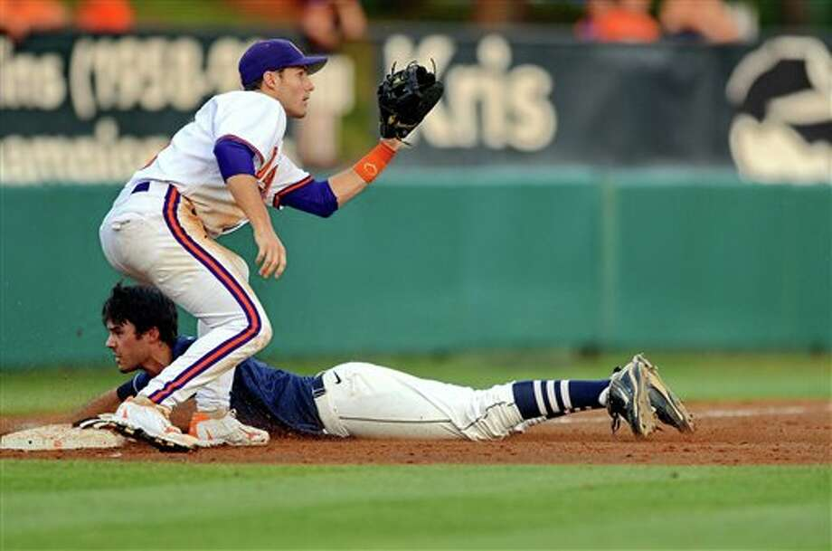 Connecticut's Billy Ferriter slides safely into third after hitting a triple in the top of he fifth inning during an NCAA college baseball regional tournament game against Clemson at Doug Kingsmore Stadium Monday, June 6, 2011, in Clemson, S.C. (AP Photo/ Richard Shiro) Photo: AP