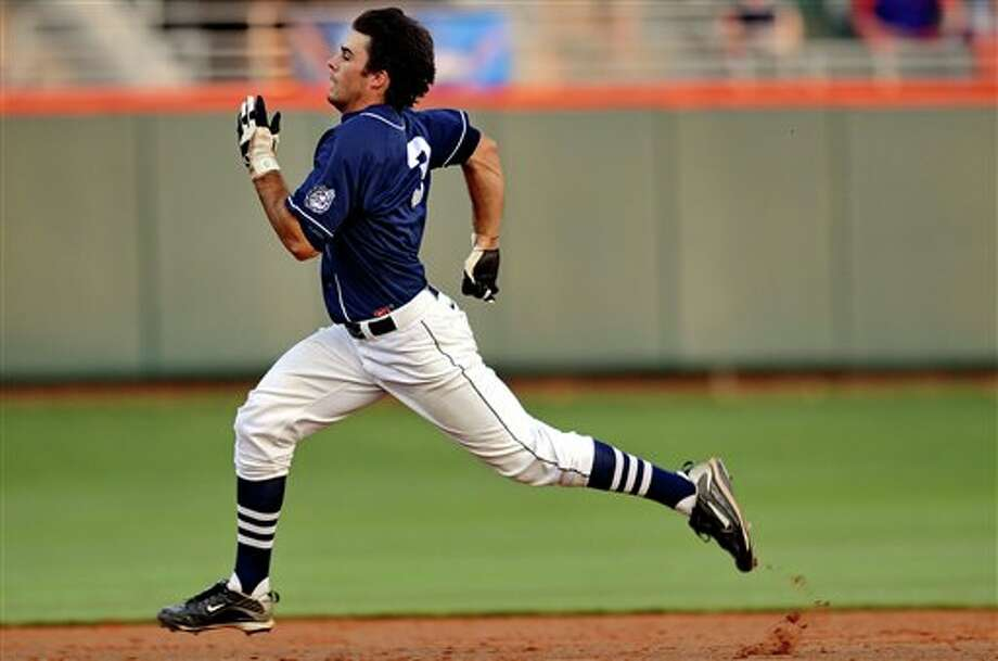 Connecticut's Billy Ferriter races around the bases after hitting a triple in the top of he fifth inning during an NCAA college baseball regional tournament game against Clemson at Doug Kingsmore Stadium Monday, June 6, 2011, in Clemson, S.C. (AP Photo/ Richard Shiro) Photo: AP