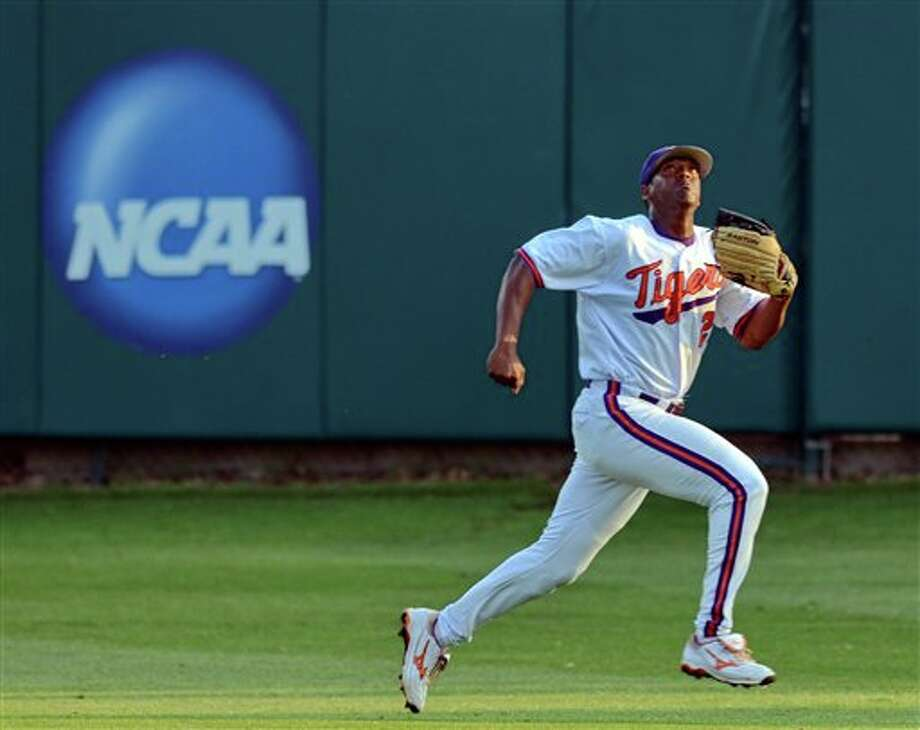 Clemson right fielder Chris Epps chases after a fly ball during an NCAA college baseball regional tournament game against Connecticut at Doug Kingsmore Stadium Monday, June 6, 2011, in Clemson, S.C. (AP Photo/ Richard Shiro) Photo: AP