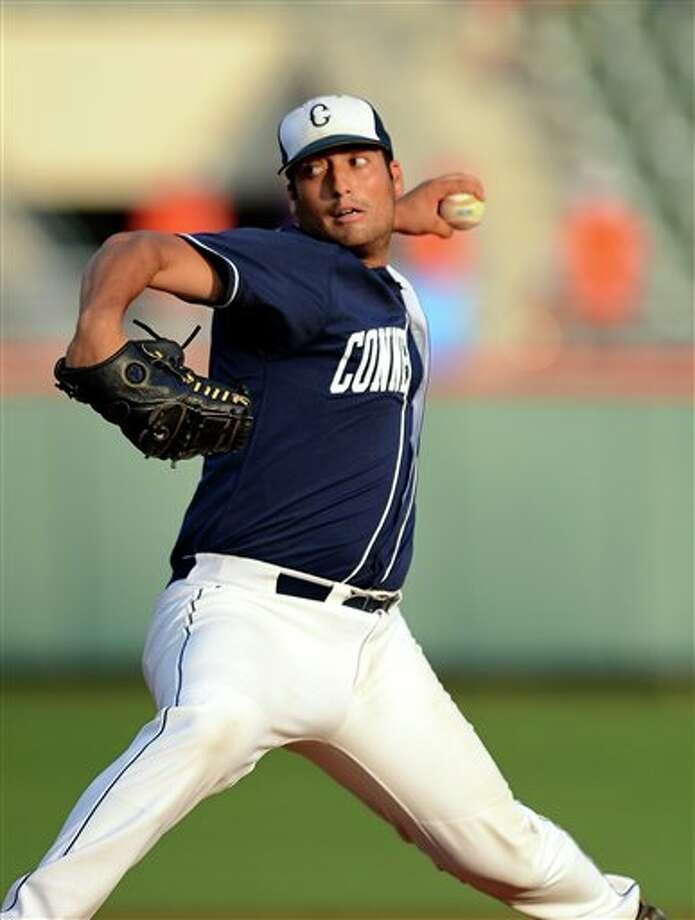 Connecticut starting pitcher Greg Nappo delivers a pitch during an NCAA college baseball regional tournament game against Clemson at Doug Kingsmore Stadium Monday, June 6, 2011, in Clemson, S.C. (AP Photo/ Richard Shiro) Photo: AP