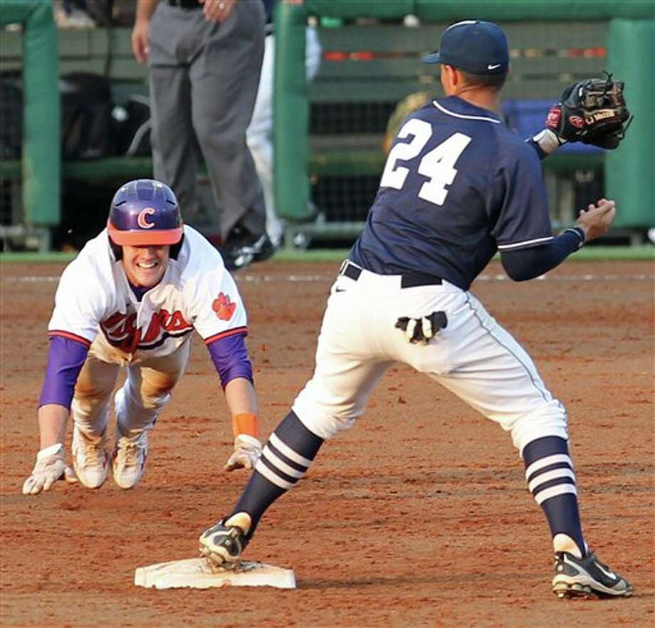 Connecticut second baseman L.J. Mazzilli (24) turns a double play as he tags the bag before Clemson runner John Hinson can get back during their NCAA regional college baseball game on Monday, June, 6, 2011 at Doug Kingsmore Stadium in Clemson, S.C. (AP Photo/Anderson Independent-Mail, Mark Crammer) Photo: AP
