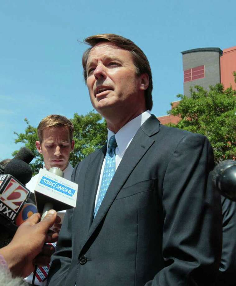FILE - In this June 3, 2011 file photo, former presidential candidate John Edwards outside federal court appearance in Winston-Salem, N.C. Prosecutors have obtained emails between John Edwards and a former aide to use as evidence at trial that he knew about payments to his pregnant mistress even while he was publicly denying it, people familiar with the case told The Associated Press on Monday. (AP Photo/Gerry Broome, File) Photo: Gerry Broome