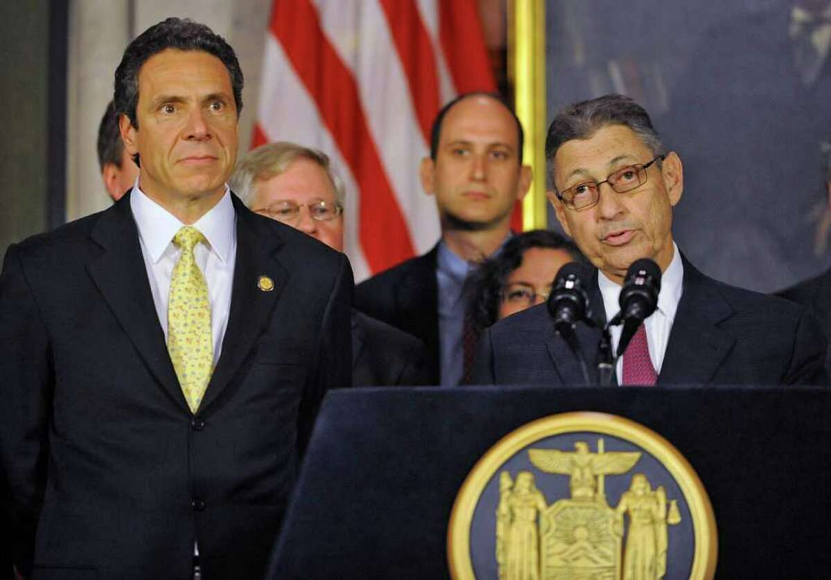 From left, Governor Andrew Cuomo and Assembly Speaker Sheldon Silver talk about an ethics deal during a press conference at the Capitol in Albany, N.Y. Monday June 6, 2011. (Lori Van Buren / Times Union)