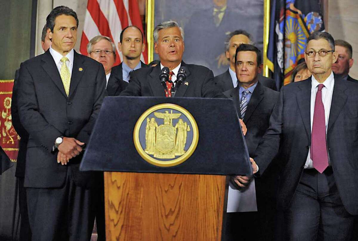 From left, Governor Andrew Cuomo, Senator Dean Skelos and Assembly Speaker Sheldon Silver talk about an ethics deal during a press conference at the Capitol in Albany, N.Y. Monday June 6, 2011. (Lori Van Buren / Times Union)