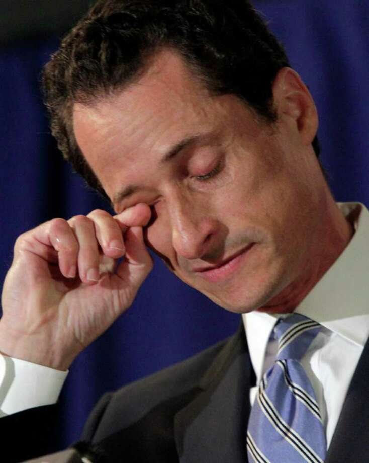 "U.S. Congressman Anthony Weiner, D-NY, wipes his eye during a news conference in New York,  Monday, June 6, 2011. After days of denials, a choked-up New York Democratic Rep. Anthony Weiner confessed Monday that he tweeted a bulging-underpants photo of himself to a young woman and admitted to ""inappropriate"" exchanges with six women before and after getting married. (AP Photo/Richard Drew) Photo: Richard Drew"