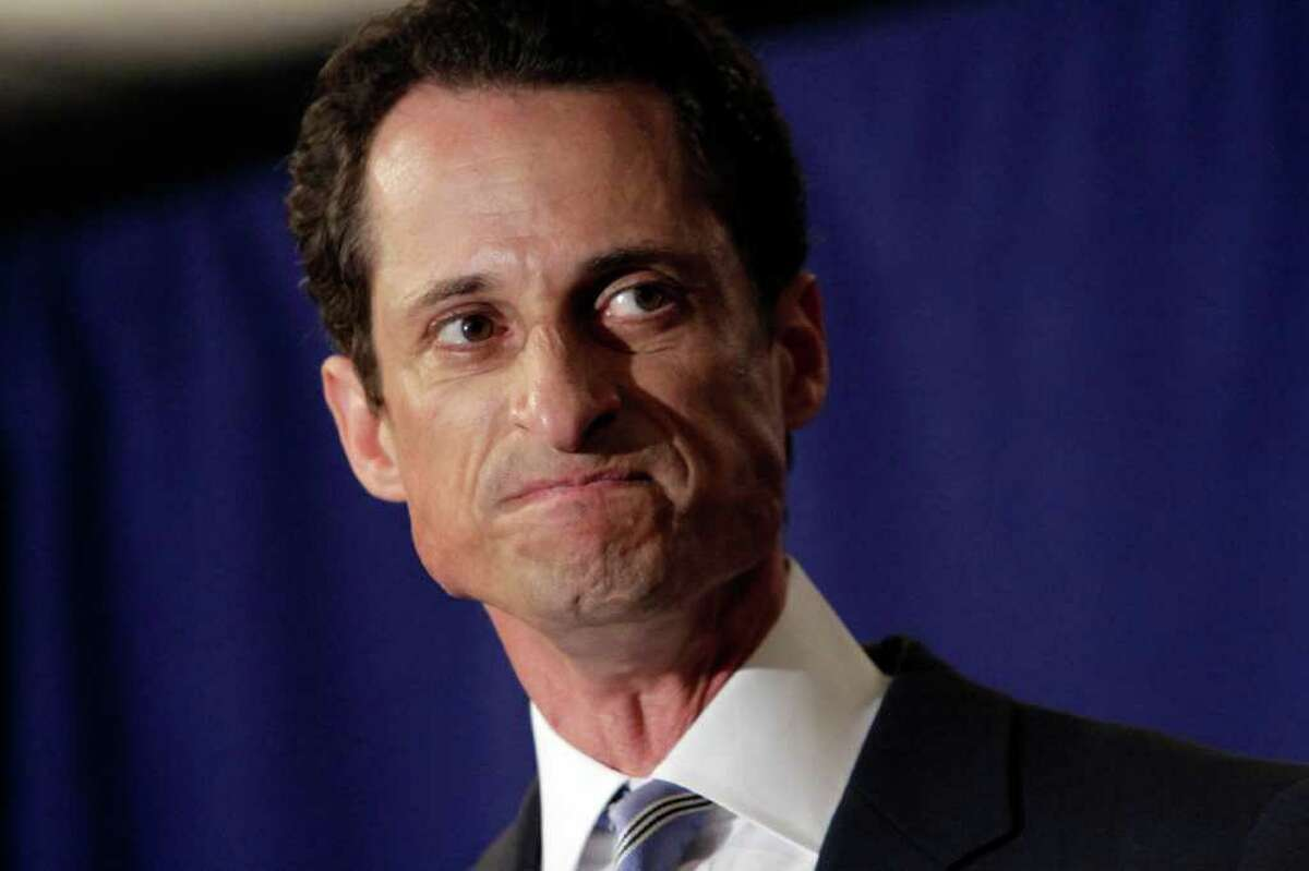 """U.S. Rep. Anthony Weiner, D-N.Y., reacts during a news conference in New York, Monday, June 6, 2011. After days of denials, a choked-up New York Democratic Rep. Anthony Weiner confessed Monday that he tweeted a bulging-underpants photo of himself to a young woman and admitted to """"inappropriate"""" exchanges with six women before and after getting married. (AP Photo/Richard Drew)"""