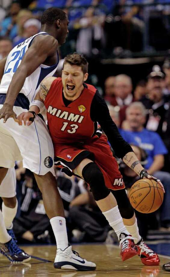 Miami Heat's Mike Miller (13) drives past Dallas Mavericks' Ian Mahinmi (28) during the first half of Game 3 of the NBA Finals basketball game Sunday, June 5, 2011, in Dallas. Photo: David J. Phillip/Associated Press