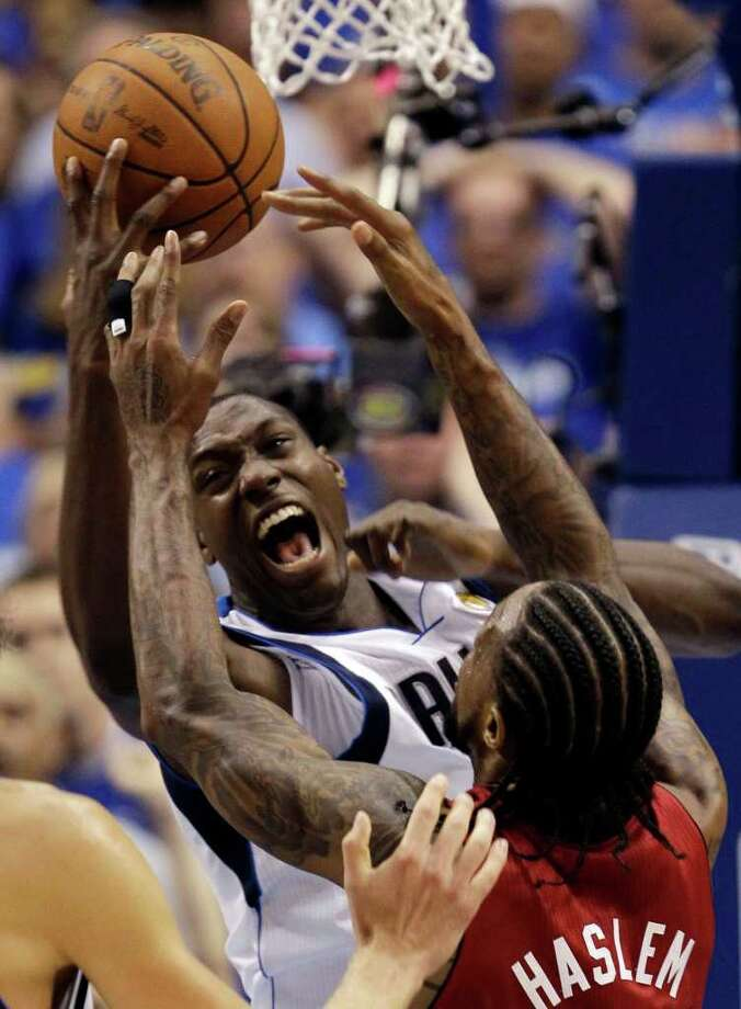 Dallas Mavericks' Ian Mahinmi grabs a rebound in front of Miami Heat's Udonis Haslem during the second half of Game 3 of the NBA Finals basketball game Sunday, June 5, 2011, in Dallas. Photo: David J. Phillip/Associated Press