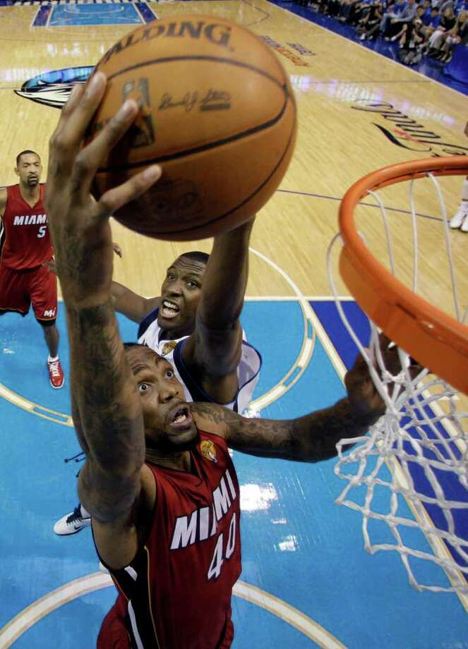 Miami Heat's Udonis Haslem (40) shoots past Dallas Mavericks' Ian Mahinmi during the second half of Game 3 of the NBA Finals basketball game Sunday, June 5, 2011, in Dallas. Photo: David J. Phillip/Associated Press