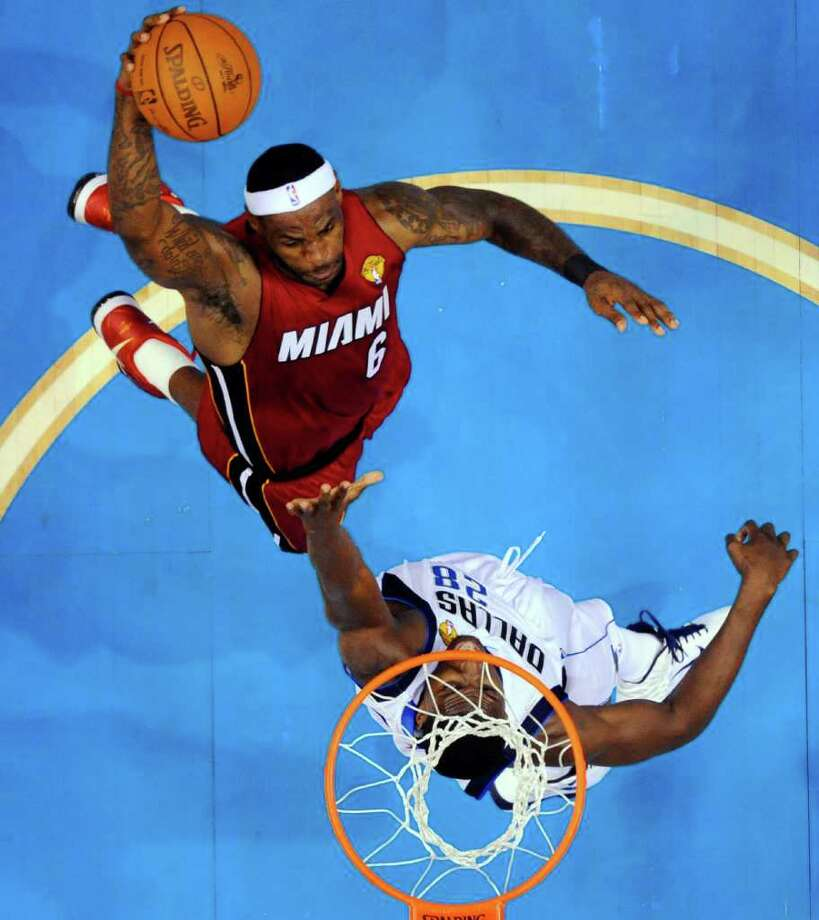 Miami Heat's LeBron James goes up for a dunk against Dallas Mavericks' Ian Mahinmi (28) during the second half of Game 3 of the NBA Finals basketball game Sunday, June 5, 2011, in Dallas. The Heat won 88-86 take a 2-1 lead in the series. Photo: Larry W. Smith/Associated Press
