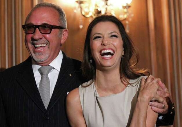 Emilio Estefan,  vice chair, National Museum of the American Latino Commission, left, and actress Eva Longoria laugh at a news conference  on Capitol Hill Thursday, May 5, 2011 in Washington, where they discussed the National Museum of the American Latino. Photo: AP