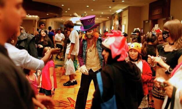 David Antunes, dressed as Mad Hatter, center, walks around other participants of the San Japan :3 Anime Convention at the Marriott hotel on July 10, 2010. Photo by Ivan Pierre Aguirre/iaguirre@express-news.net Photo: Ivan Pierre Aguirre, San Antonio Express-News / iaguirre@express-news.net
