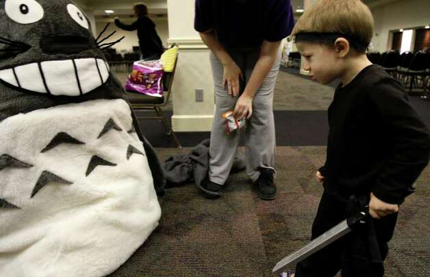 Ninja Keagan Moritz, 3, looks over a Totoro costume during San Japan 2.x at the Tropicana Hotel, Sunday, August 16, 2009.   JERRY LARA/glara@express-news.net Photo: JERRY LARA, San Antonio Express-News / glara@express-news.net