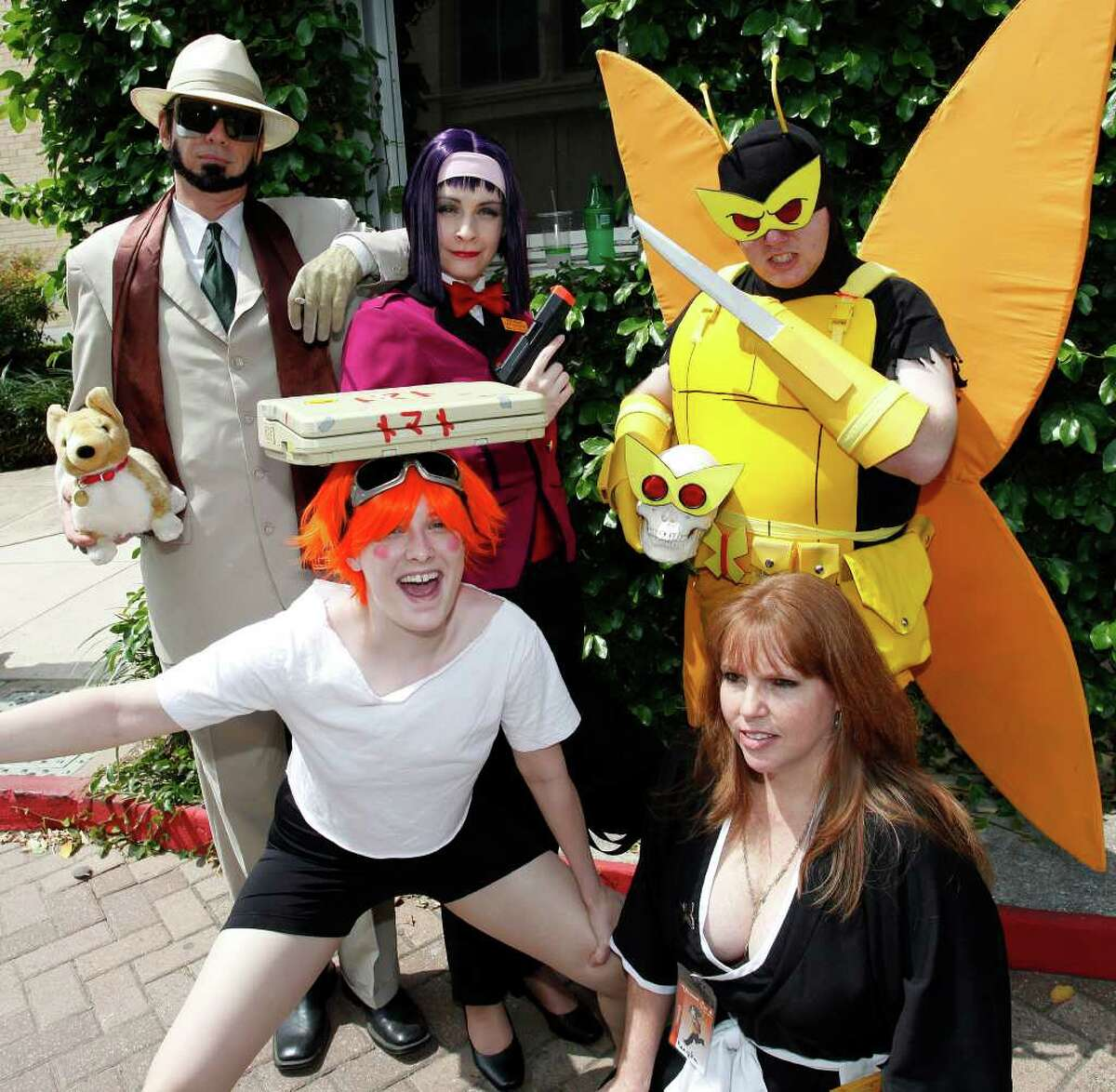 """FEATURES; ACS MIZUUMI CON JMS; 03/26/11; From the left in front, Honey Cherry as """"Ed"""", Red Rogers as """"Rangiku"""" back row from the left Jet_Texas as """"Jet Black"""", Maromi as """"Faye Valentine"""" and Shadowfox as """"Henchman 21"""" at Muzuumi-Con 4, anime convention, Saturday, March 26, 2011, at Our Lady of the Lake University in San Antonio. ( Photo by J. Michael Short / SPECIAL )"""