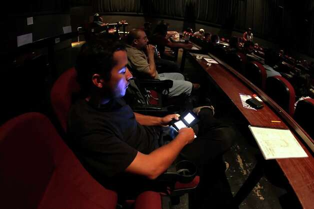 Juan Larraga plays a game on his Nintendo DS before a showing of Japanese anime at Alamo Drafthouse Westlakes on Monday, Sept. 6, 2010. The movie venue has been offering anime to fans of the genre for more than five years.  Kin Man Hui/kmhui@express-news.net Photo: KIN MAN HUI, SAN ANTONIO EXPRESS-NEWS / San Antonio Express-News