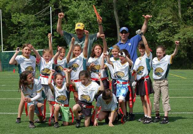 The Greenwich Flag Football League 10 and under girls championship went to the Jacksonville Jaguars. Pictured here are: Front row, from left Julie Gambino, Marissa Morganti, Jenna Marianaccio, Carlyn Marianaccio  Second row, from left, Erin O'Keefe, Kelly Brogan, Michelle Morganti, Skylar Shack, Jessica Spitzer, Caroline Thomas, Katie Large, Catlin Burke and Nicole Maloney. In the back row, from left, are coaches Glenn Brogan and Mike Morganti. Photo: Contributed Photo / Greenwich Citizen