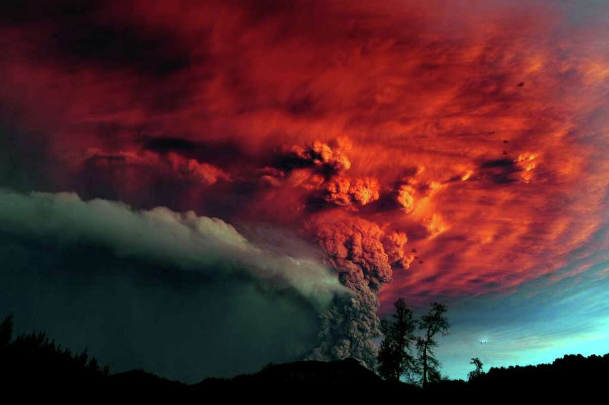 A cloud of ash billowing from Puyehue volcano near Osorno in southern Chile on Sunday. Puyehue volcano erupted for the first time in half a century on Saturday, prompting evacuations for 3,500 people as it sent a cloud of ash that reached Argentina. The National Service of Geology and Mining said the explosion that sparked the eruption also produced a column of gas 10 kilometers (6 miles) high, hours after warning of strong seismic activity in the area. AFP PHOTO/CLAUDIO SANTANA