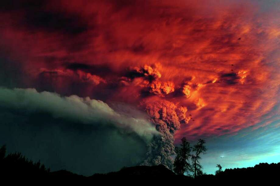 A cloud of ash billowing from Puyehue volcano near Osorno in southern Chile on Sunday. Puyehue volcano erupted for the first time in half a century on Saturday, prompting evacuations for 3,500 people as it sent a cloud of ash that reached Argentina. The National Service of Geology and Mining said the explosion that sparked the eruption also produced a column of gas 10 kilometers (6 miles) high, hours after warning of strong seismic activity in the area.  AFP PHOTO/CLAUDIO SANTANA Photo: CLAUDIO SANTANA, AFP/Getty Images / 2011 AFP