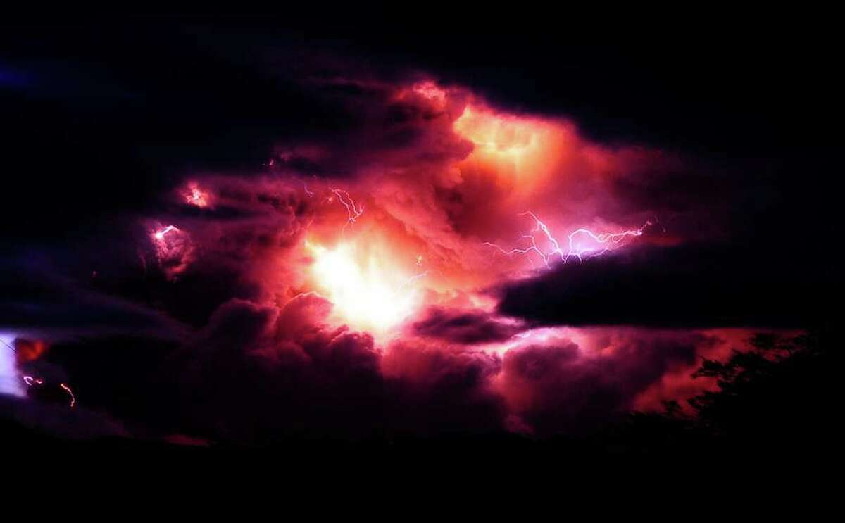 A column of smoke and volcanic lightning are seen over the Puyehue volcano, over 500 miles south of Santiago, Chile, on Sunday. (AP Photo/Francisco Negroni, AgenciaUno)