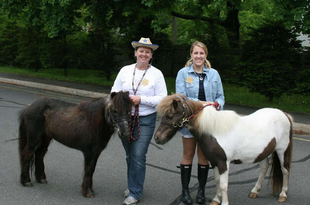 Round Up Co-Chairmen Allison Ball (left) and Shannon Silsby lassoed some old fashioned fun for Royle School's kids. Photo: Contributed Photo / Darien News