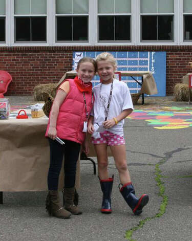 Second-graders Clara Baurmeister and Courtney Ball smile at the Royle Round Up. Photo: Contributed Photo / Darien News