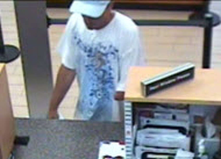 Albany police have released this surveillance photo of a man suspected of robbing the SEFCU branch at 16 New Scotland Ave. just after noon Tuesday, June 7. The suspect is missing his left arm from the elbow down. Police Thursday said they charged Carmen Palella, 39, of Schenectady, a career criminal, with the robbery.  (Provided by Albany police)
