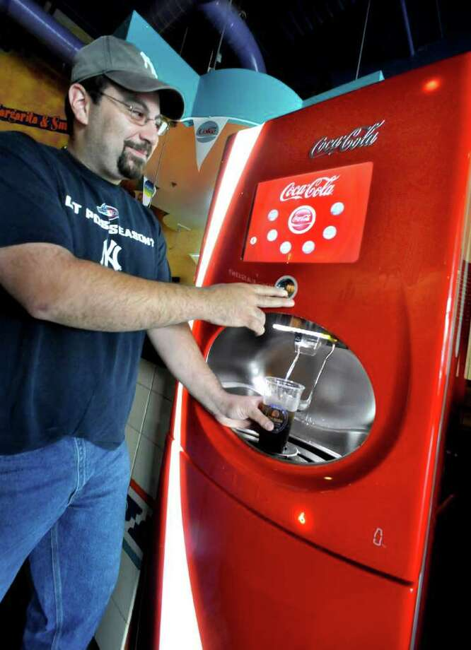 Nick Shikarides, of Lake Carmel, N.Y. uses the new Coke Freestyle machine at the Desert Moon Cafe in Danbury, Monday, June 6, 2011. Photo: Michael Duffy / The News-Times