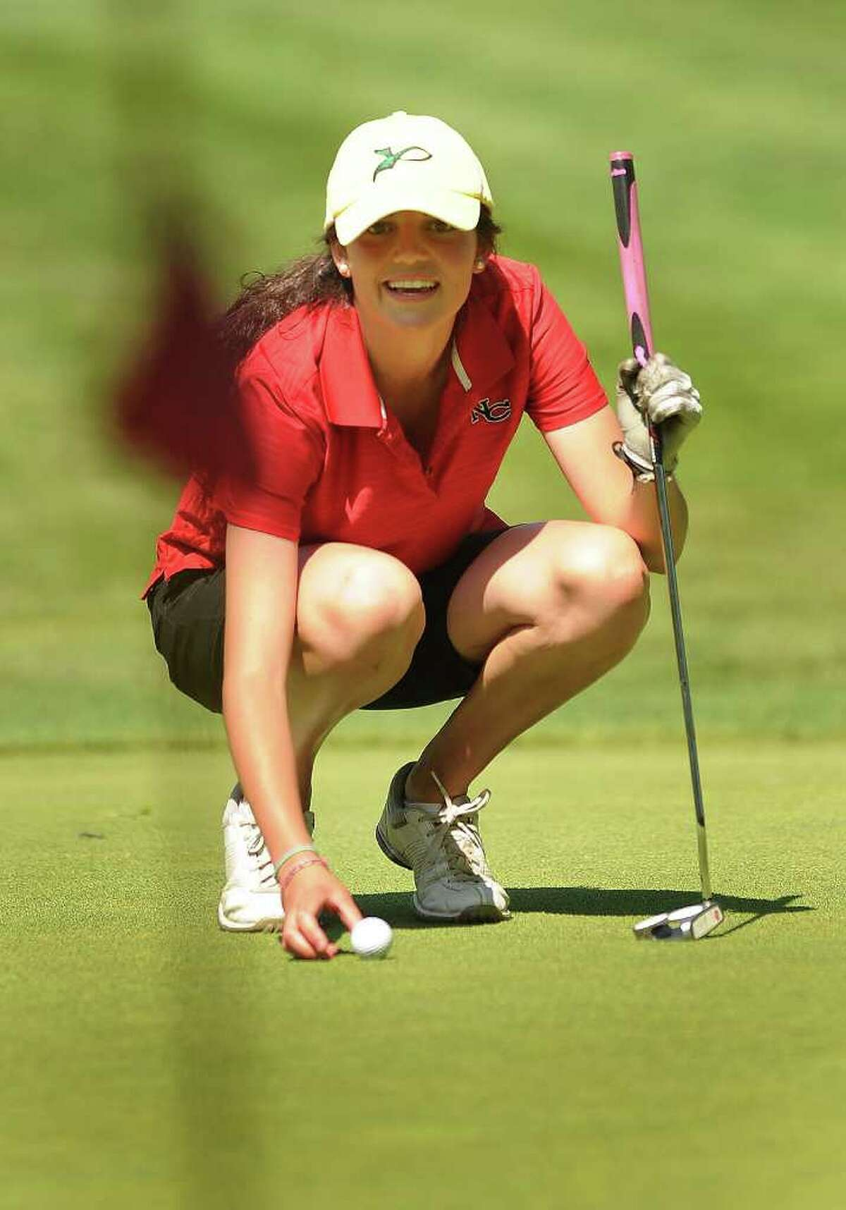 New Canaan's Krissy Parrett lines up a putt on the 10th green at the 2011 Girls Golf State Tournament at Orange Hills Country Club in Orange on Tuesday, June 7, 2011.