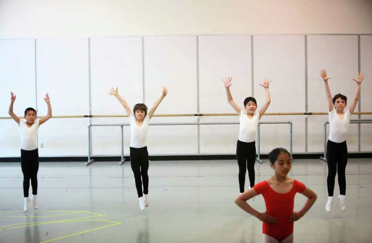 Students perform during Pacific Northwest Ballet's 17th annual DanceChance observation day on Tuesday, June 7, 2011. Students in the program showcased what they learned during a show for parents, family, friends and supporters. Students in the program study dance twice per week during the school year. The program auditioned over 1,500 students from 18 partner schools in Seattle and three in Bellevue. 38 performed on Tuesday. DanceChance provides attire, transportation and complimentary tickets to PNB performances for children that might not otherwise have a chance to pursue a dance career.