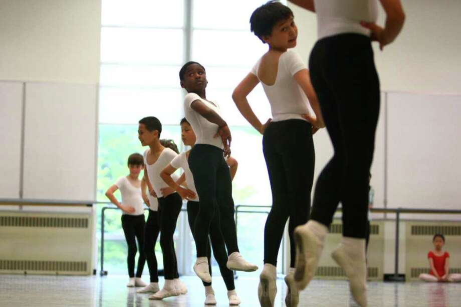 Students, including Kevonte Brown, center left, from Graham Hill Elementary, and Giovannie Dang, center right, from Arbor Heights, perform during Pacific Northwest Ballet's 17th annual DanceChance observation day. Photo: JOSHUA TRUJILLO / SEATTLEPI.COM