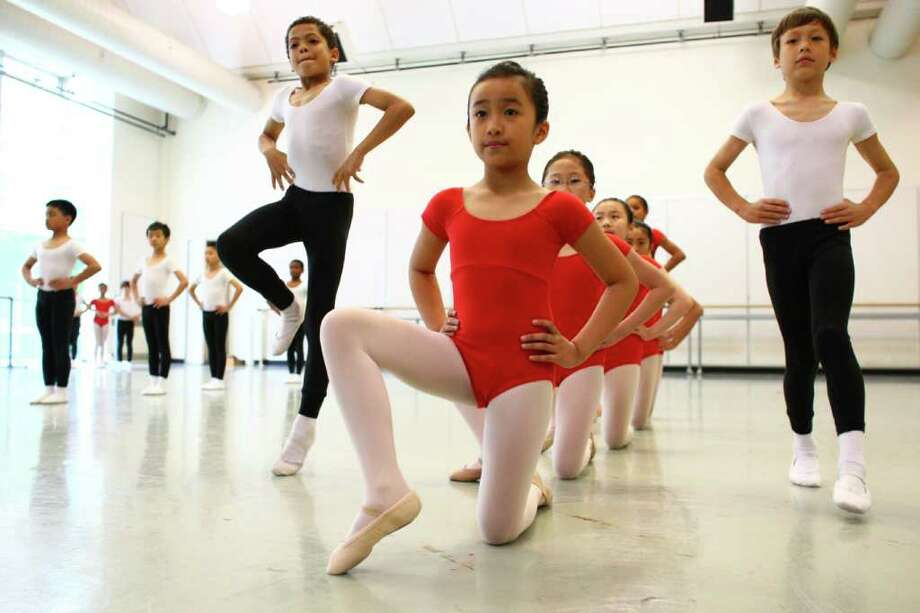 Alexis Calonge, a student from Dearborn Park Elementary, center, performs with classmates during Pacific Northwest Ballet's 17th annual DanceChance observation day. Photo: JOSHUA TRUJILLO / SEATTLEPI.COM