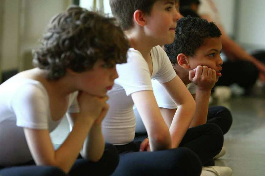 Students watch classmates perform during Pacific Northwest Ballet's 17th annual DanceChance observat