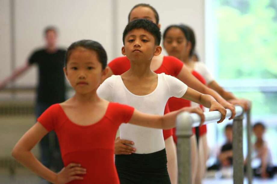 Student Xue Ying Xu, center, performs with classmates during Pacific Northwest Ballet's 17th annual DanceChance observation day on Tuesday. Photo: JOSHUA TRUJILLO / SEATTLEPI.COM
