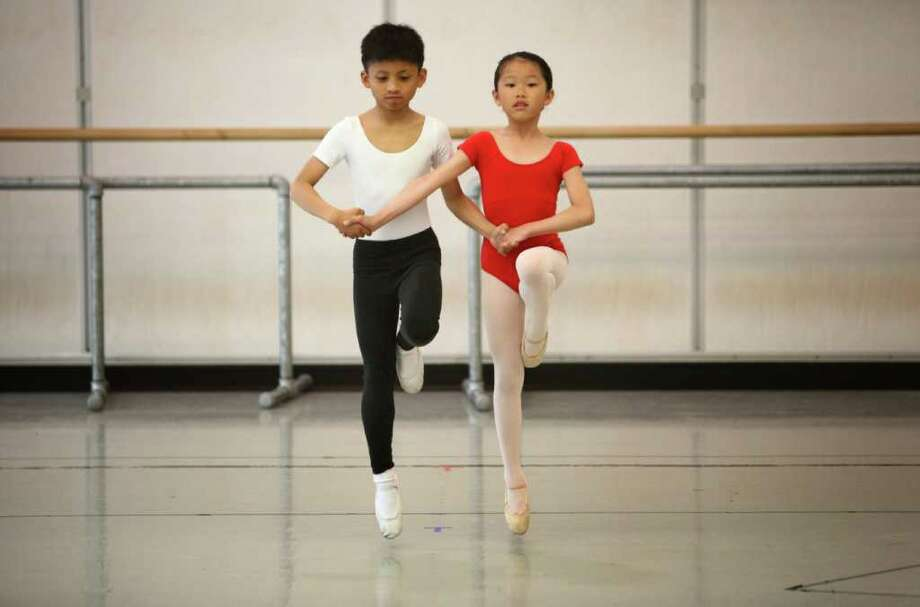 Students Xue Ying Xu, left, and Bj Magcalas perform during Pacific Northwest Ballet's 17th annual DanceChance observation day. Photo: JOSHUA TRUJILLO / SEATTLEPI.COM