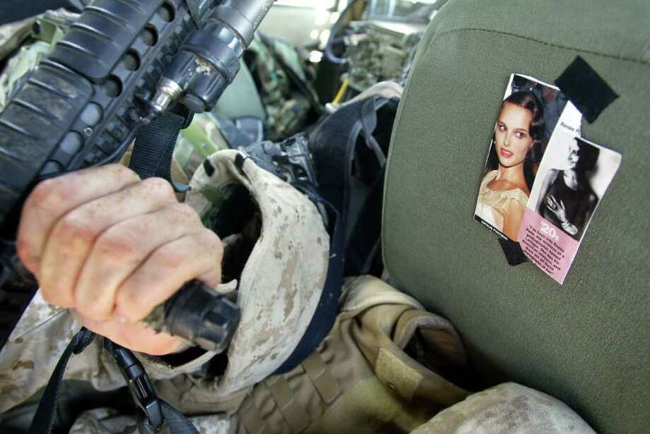 A picture of Portman appears on the back seat of a U.S. marine Humvee deployed in Ramadi, Iraq on November 4, 2004. Photo: PATRICK BAZ, AFP/Getty Images / 2004 AFP
