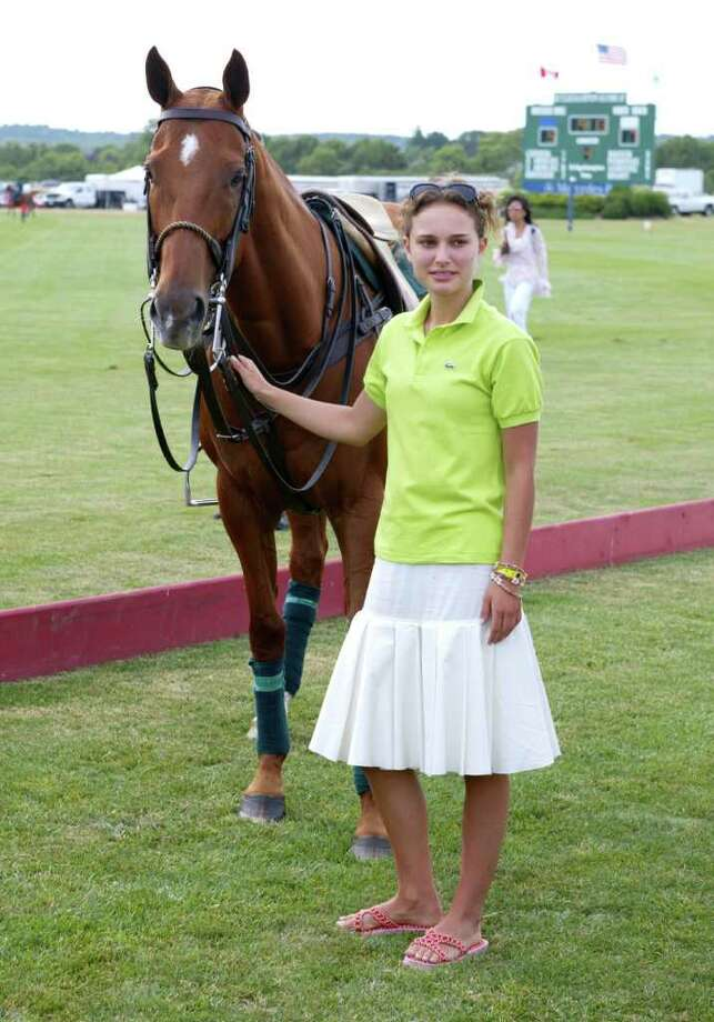 Portman tends a polo pony at the 8th annual Mercedes-Benz Polo Challenge on July 13, 2002. Photo: Matthew Peyton, Getty Images / Getty Images