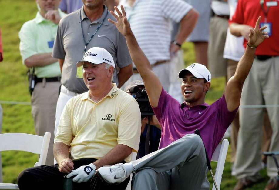 Tiger Woods and Mark O'Meara, left,  cheer after Wood's caddie Steve Williams, not shown, makes a shot on the 17th green during a practice round for The Players Championship golf tournament, Wednesday May 11, 2011 in Ponte Vedra Beach, Fla. (AP Photo/Chris O'Meara) Photo: AP