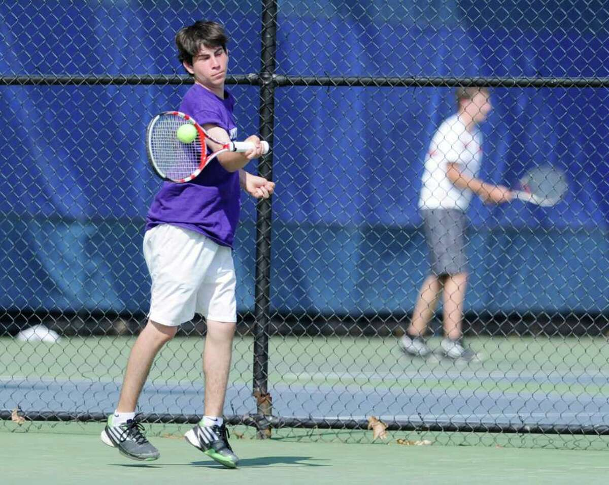 Brendon Promerance of Westhill High School during doubles match in State Open Tennis Semifinals at Yale University, New Haven, Tuesday afternoon, June 7, 2011.