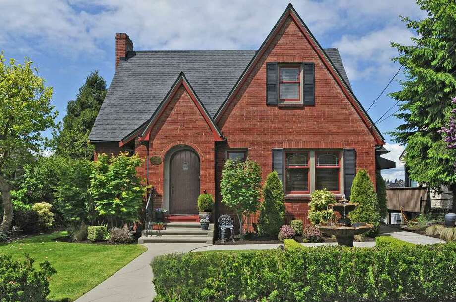 Seattle homes tend toward wooden Craftsmen, but there are some interesting exceptions, such as these brick Tudors. The first is a 3,010-square-foot home on a 5,400-square-foot lot at 2607 28th Ave. W., in Magnolia. It has three bedrooms, 2.5 baths, was built in 1931, includes original millwork, coved ceilings and an eating area with French doors, and is listed at $718,000. (Listing: http://www.windermere.com/index.cfm?fuseaction=listing.PP3ListingDetail&ListingID=130161433) Photo: Windermere Real Estate