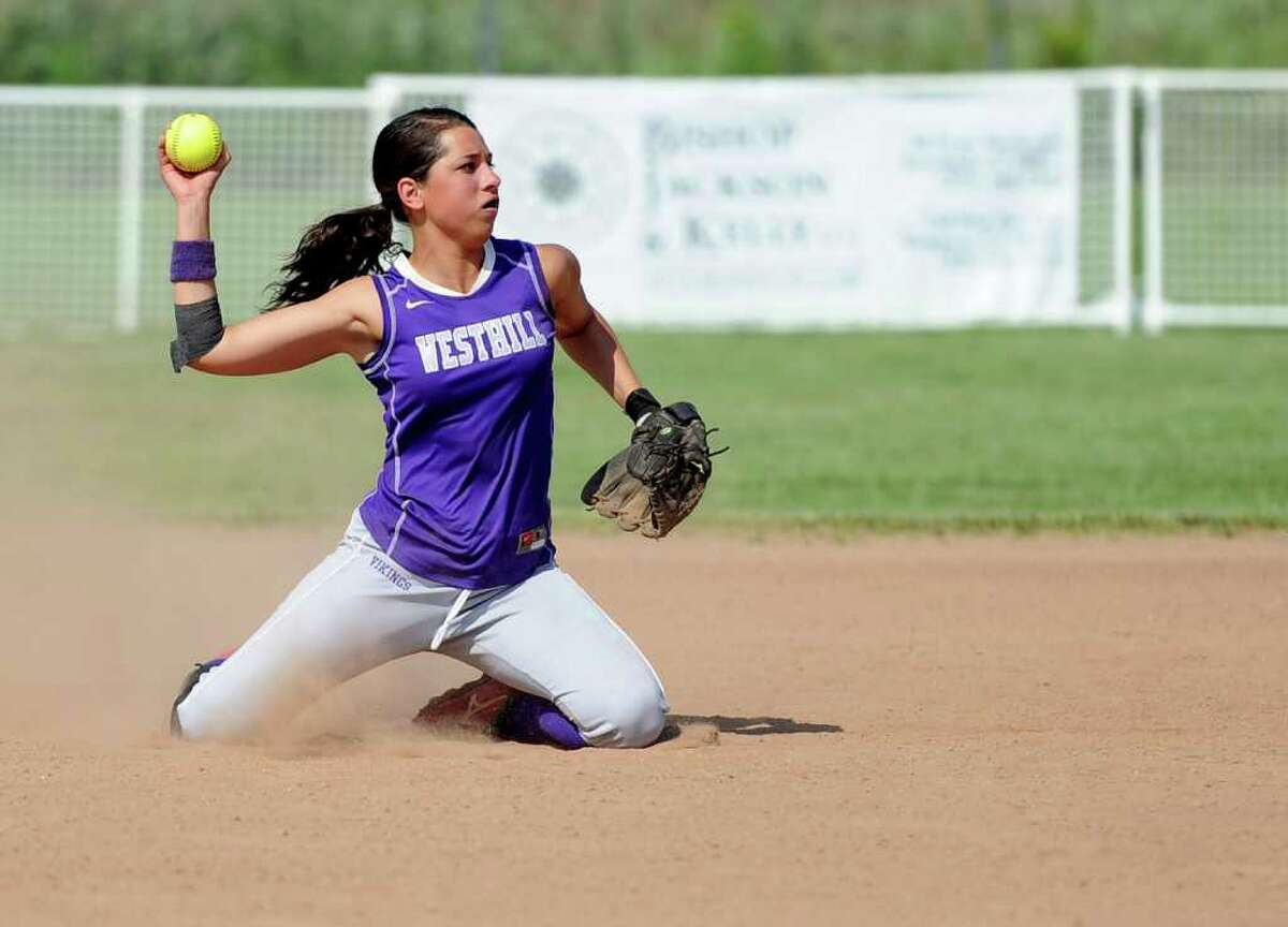Westhill's Brittany Horn throws the ball to first base from her knees for an out during Tuesday's class LL semifinal game against Bristol Central at DeLuca Field in Stratford on June 7, 2011.